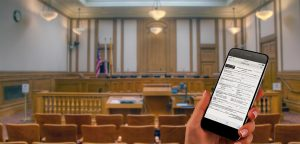 Hand holding a mobile phone in a hearing room